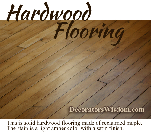 Hardwood Flooring Made of Reclaimed Maple Wood; The Stain Is an Amber Color With a Satin Finish.