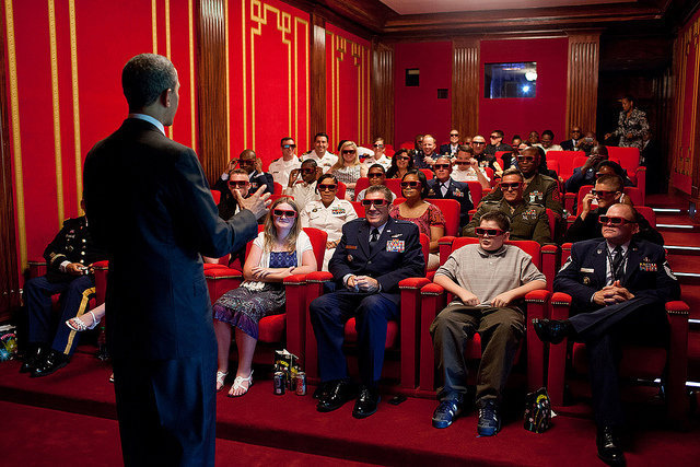 Former US President Barack Obama entertains in the White House movie theater. Pete Souza took this photo on May 25, 2012.