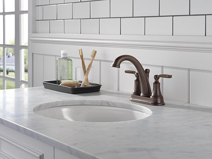 Delta Faucet's Woodhurst collection is suitable for use in traditional and transitional bathroom designs. Here you can see one of the lovely, traditionally styled bathroom faucets from this collection. Photo courtesy of Delta Faucet.
