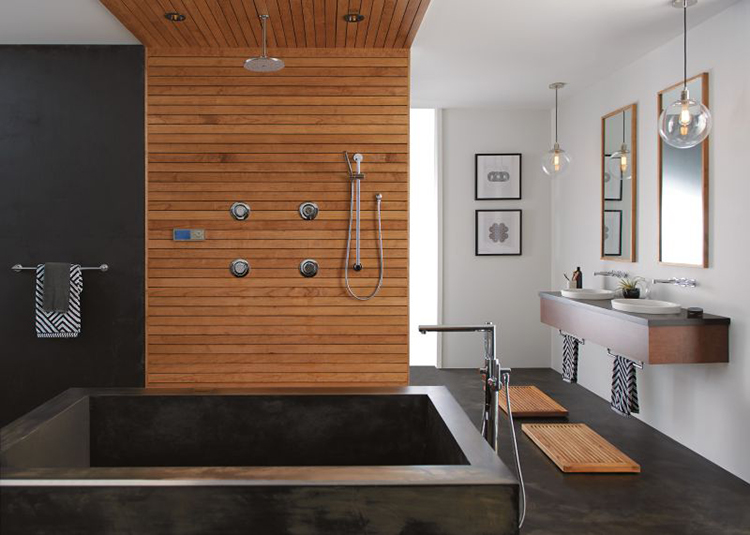 This bathroom includes bunches of elements that are on trend for 2018: Floating vanities with semi-recessed sinks; a black and white color palette with wood accents; a rainfall showerhead; and a convenient hand shower. The tub filler, shower components and faucets are all by Moen. photo courtesy of Moen.com.