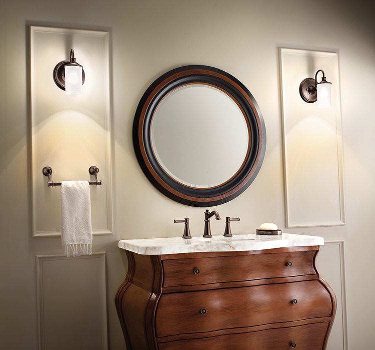 "This traditionally styled bathroom features several of the top 2018 bathroom trends: A vanity built into a piece of wood-finished furniture; a quartz vanity top that resembles marble; a dramatic statement mirror; and Moen's traditional <A TARGET=""_blank"" HREF=""https://www.moen.com/press-room/press-releases/2018jan_belfield"">Belfield bathroom fixtures</A> in the oil-rubbed bronze finish."