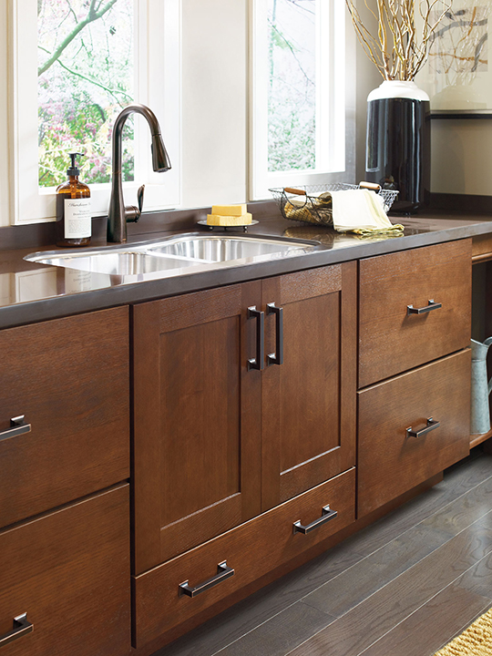 This Stylish Kitchen Features Dark Wood Finished Cabinets That Resemble  Walnut. Additional On
