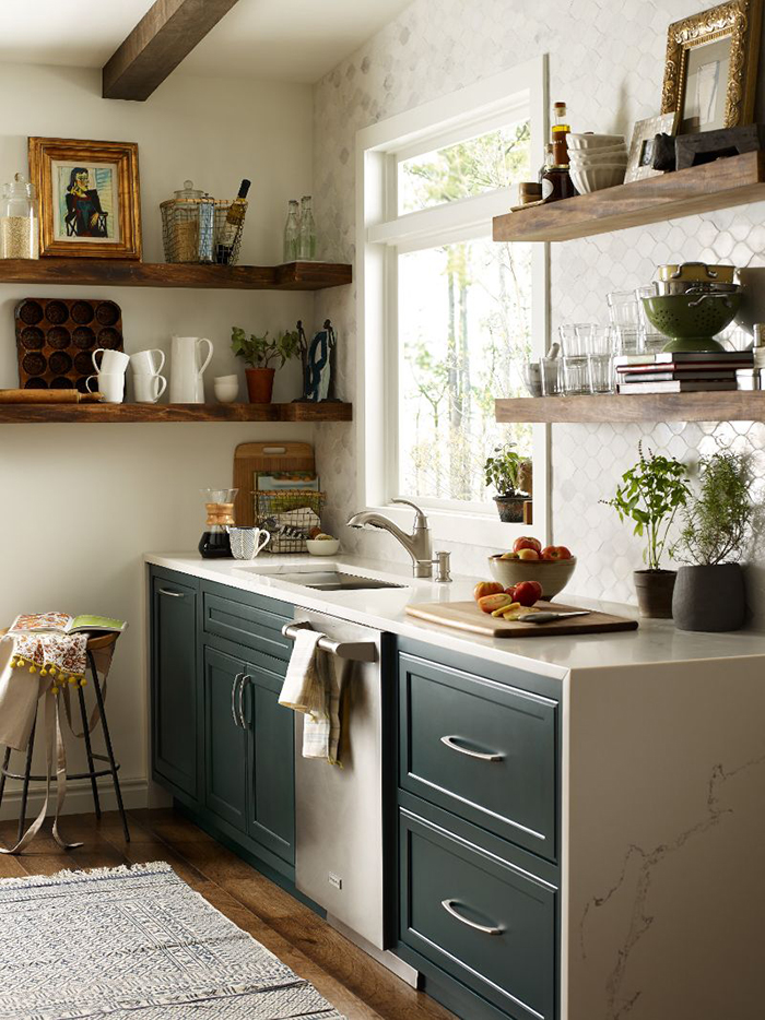 Color-blocked kitchen with open shelving, quartz countertops, and a single-lever faucet by Moen. Is the cabinetry black? Or is it an ultra dark green? Colors like greenish-black or blackish-green are a top trend for 2019. Photo courtesy of Moen.com.