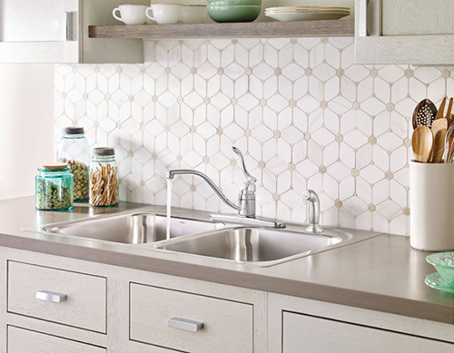 Trendy kitchen with tile backsplash, open shelving and a single-lever faucet by Moen. Photo courtesy of Moen.com.