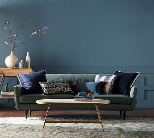 Behr's color of the year is called Blueprint. It's the medium blue wall color you see in this living room photo.