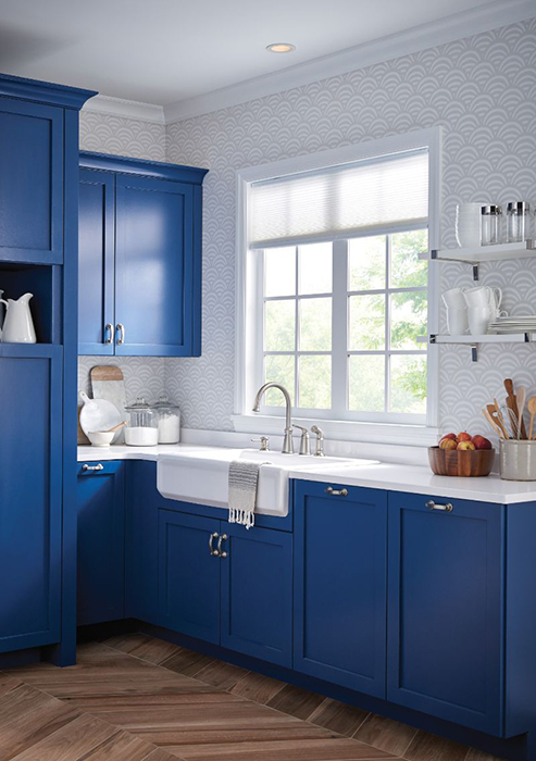 Trendy cobalt blue kitchen with parquet floor and single-lever faucet by Moen. Photo courtesy of Moen.com.