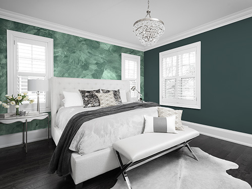 A bedroom painted in Night Watch (DLX1145-7), a deep green-black, and Mojito Shimmer (036VS), a glistening, frosted dark green. (Photo: Business Wire)
