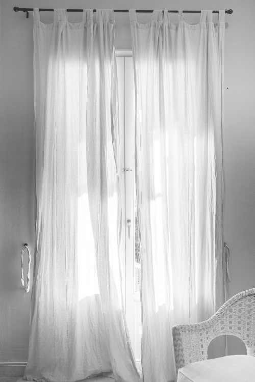 Curtains are simple but effective window treatments -- Photo by Christopher Martyn on Unsplash.com