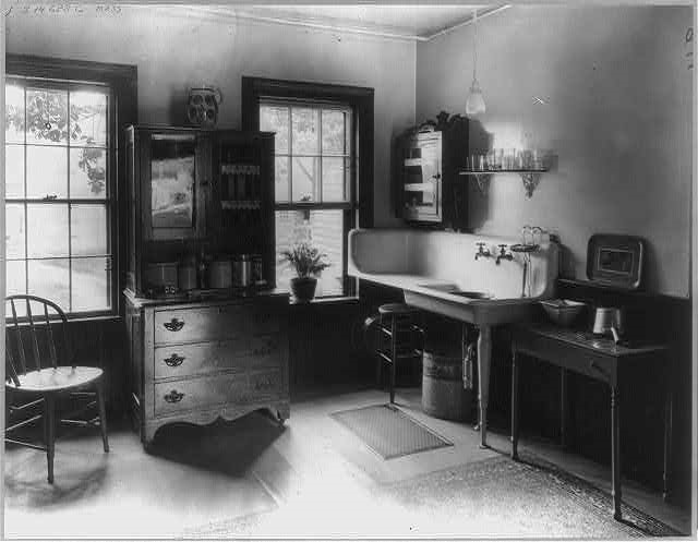 This is a vintage photo from 1925 showing you the kitchen in a Massachusetts farmhouse.