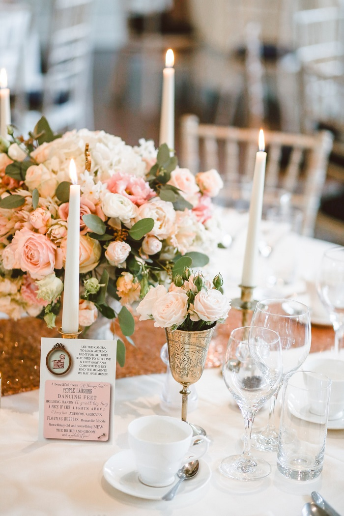 Candles lend additional elegance to this pretty table setting. Photo courtesy of Kelly Jean @kellyjean at Unsplash.com.